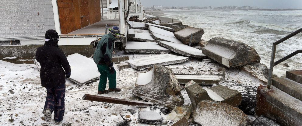 PHOTO: A large section of seawall was breached by ocean waves at the height of the blizzard and collapsed, damaging several homes in Marshfield, Mass. on Jan. 27, 2015.