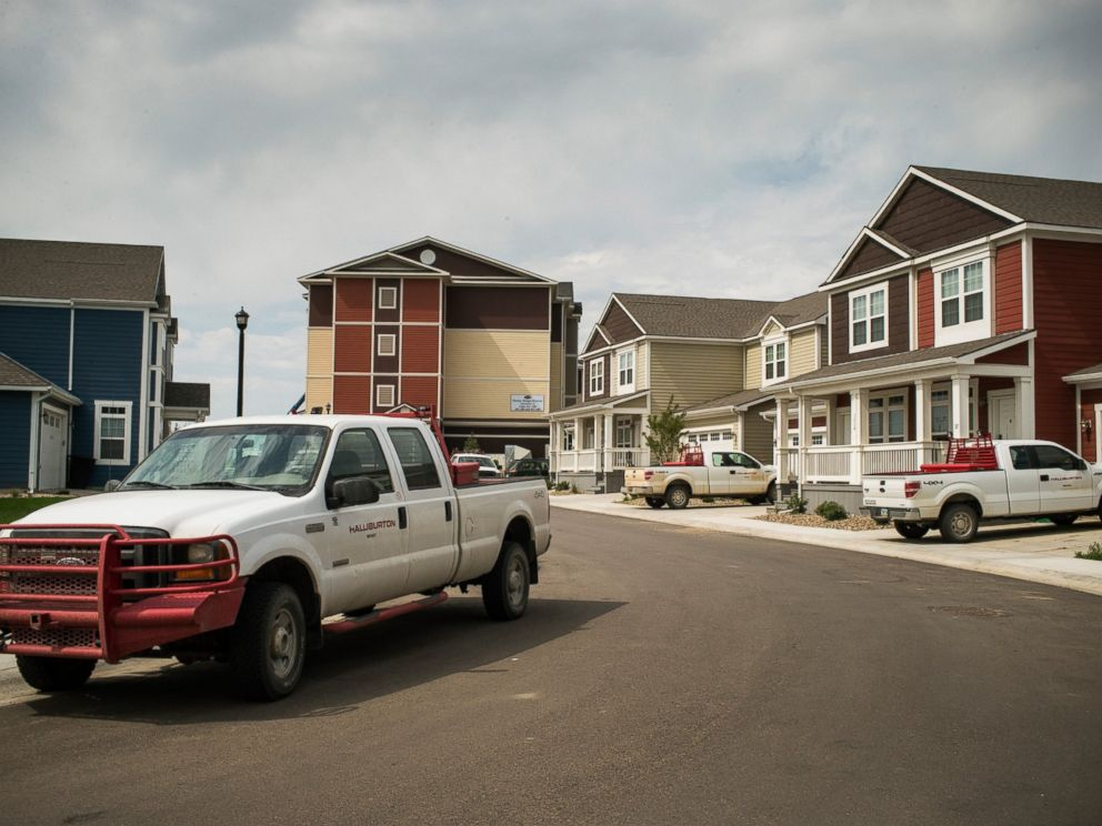 PHOTO: Trucks are parked near new homes rented by oil workers, July 28, 2013, in Williston, North Dakota.