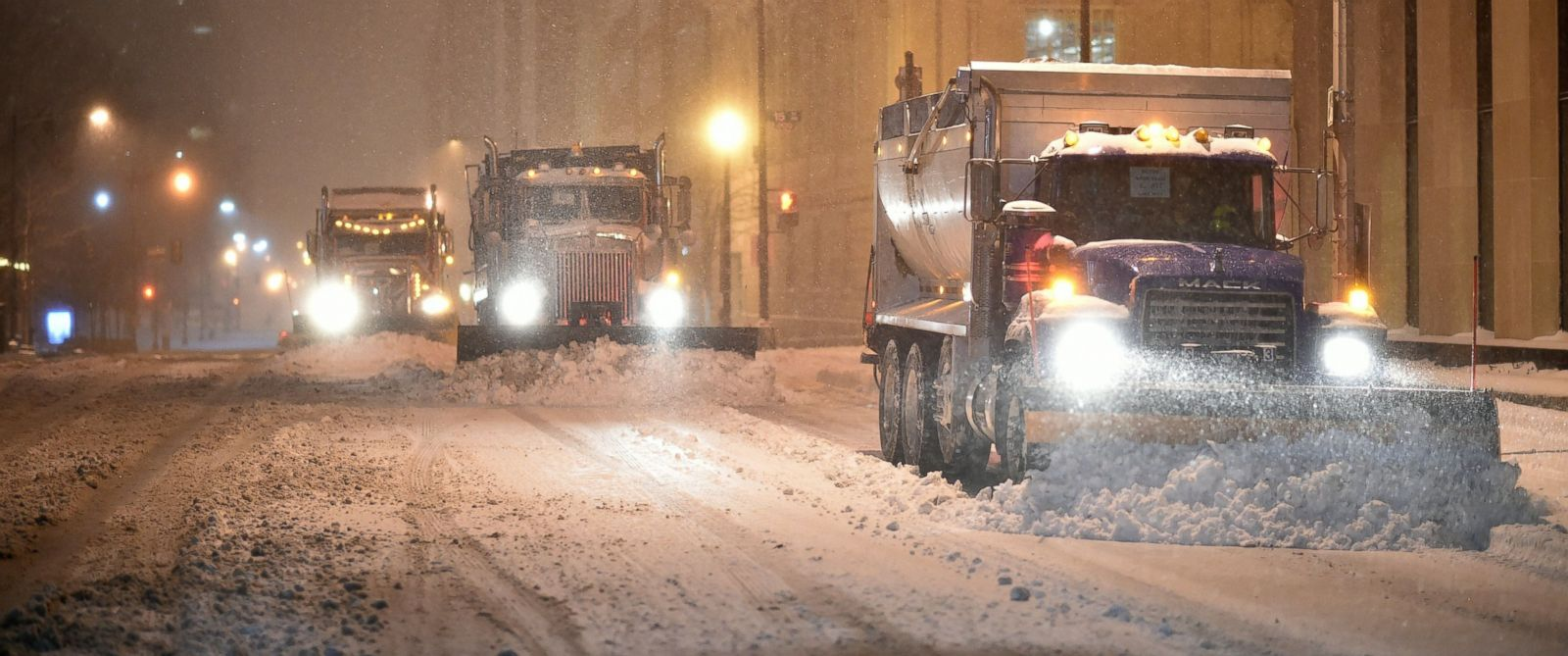 PHOTO: Snow plows clean the snow from a street during a snowstorm in downtown Washington, DC on January 22, 2016.