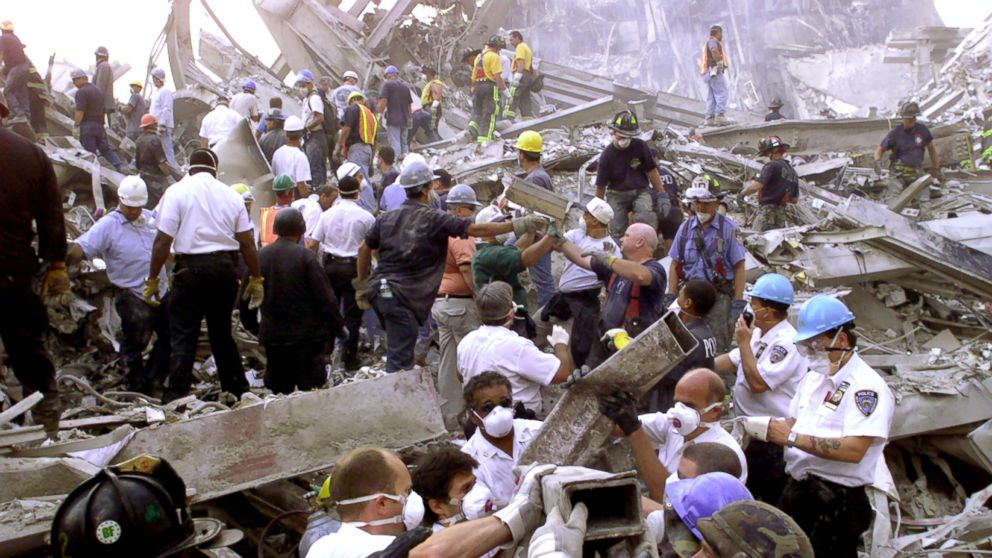 PHOTO: Rescue workers remove rubble at the World Trade Center after it was struck by a commercial airliner in a terrorist attack.