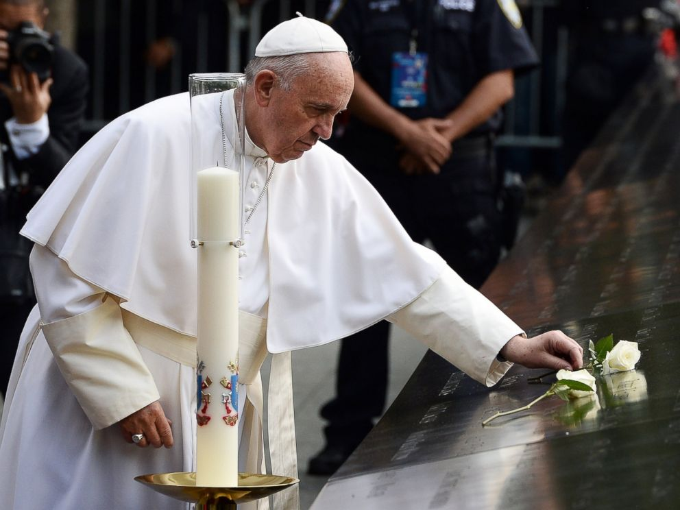PHOTO:Pope Francis places a white rose on the names of the September 11 victims at the edge of the South Pool of the 9/11 memorial in New York, Sept. 25, 2015.