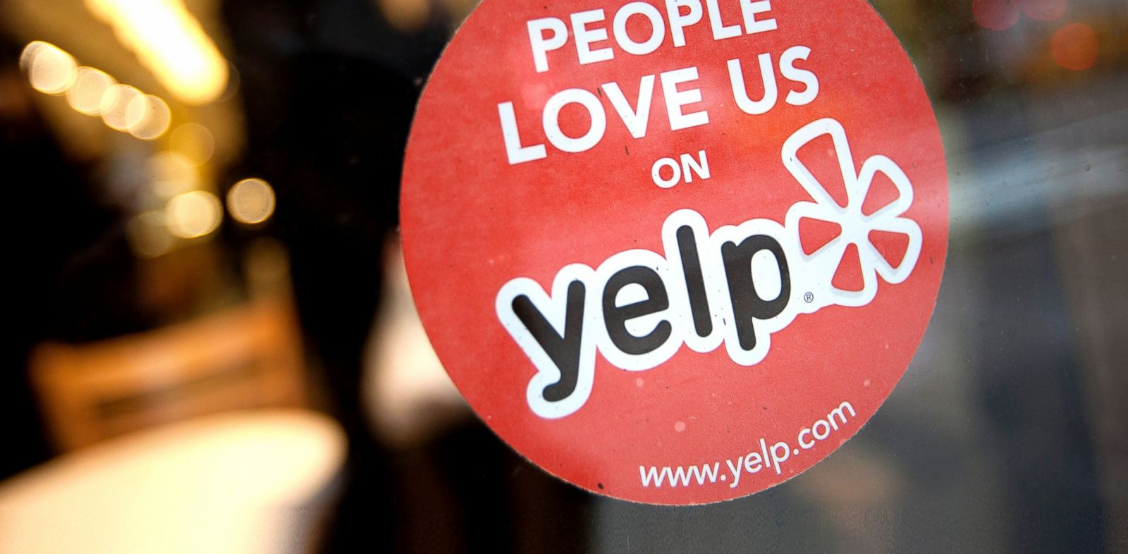 PHOTO: The Yelp Inc. logo is displayed in the window of a restaurant in New York, March 1, 2012.