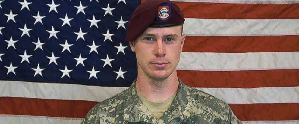 PHOTO: In this undated image provided by the U.S. Army, Sgt. Bowe Bergdahl poses in front of an American flag.