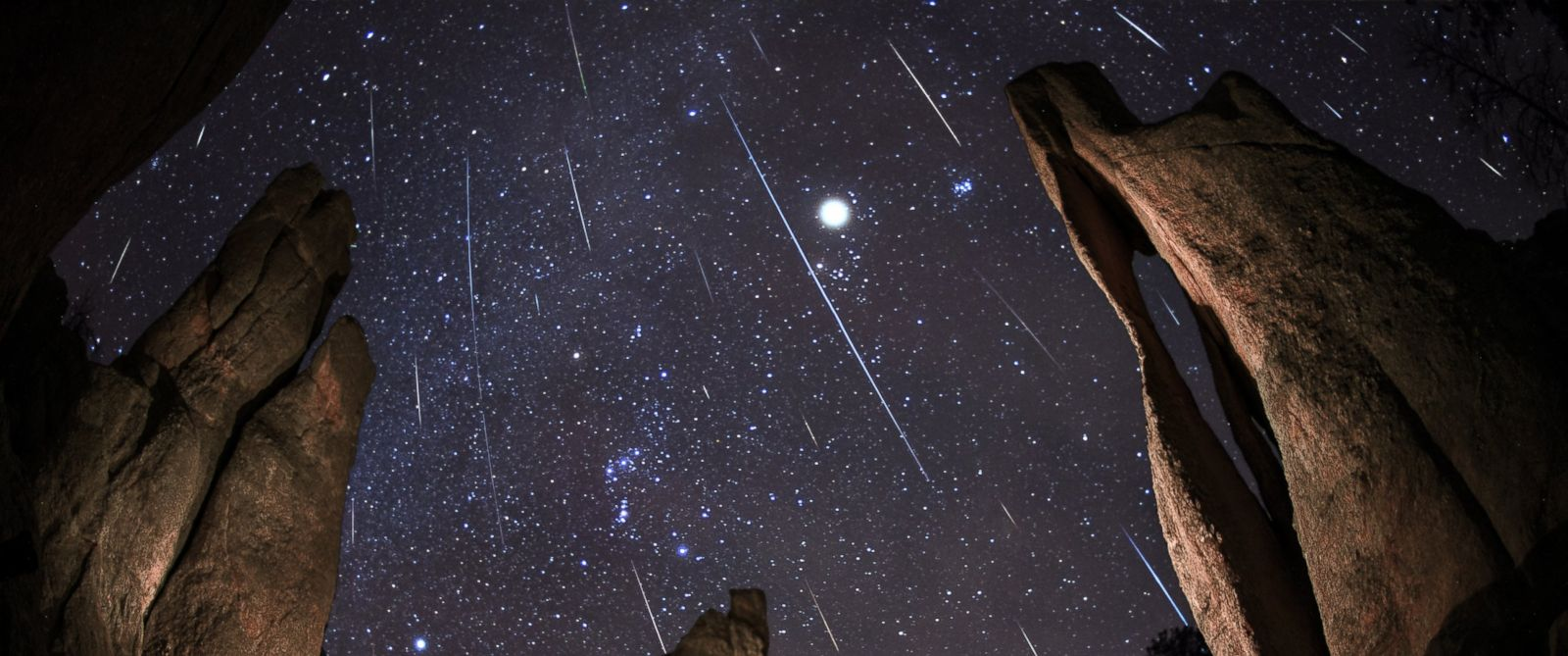 PHOTO: A Geminids Meteor Shower happens in Needles Eye in South Dakota.