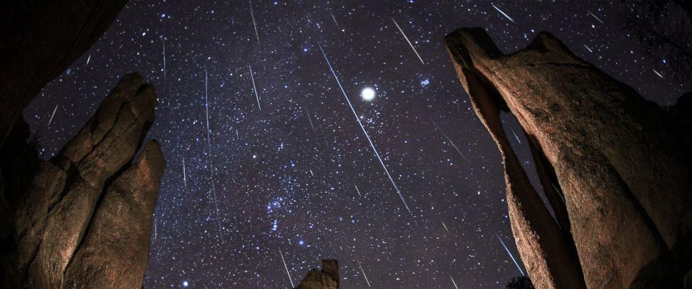 PHOTO: A Geminids Meteor Shower happens in Needles Eye in South Dakota.