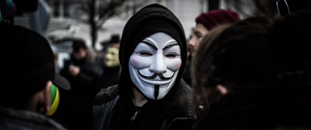 PHOTO: A person wears a Guy Fawkes mask, a trademark and symbol for the online hacktivist group Anonymous, Feb. 25, 2012.