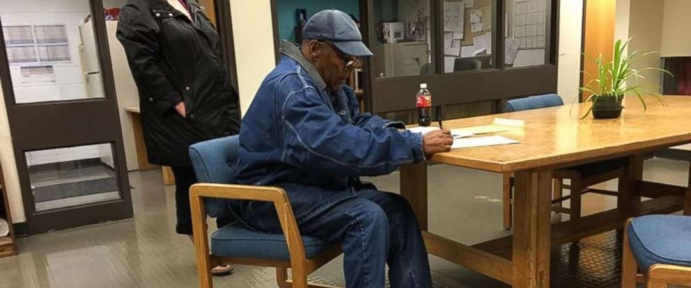 In a photo provided by the Nevada Department of Corrections, Simpson is seen signing paperwork upon his release from prison Sunday, Oct. 1, 2017.