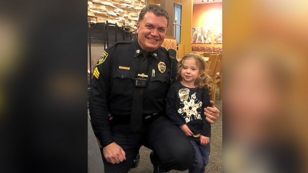PHOTO: A photograph posted on the Hingham, Mass. Police Dept. Facebook page shows Sgt. Steven Dearth with four-year-old Lillian, who came up to Dearth to introduce herself and wanted to join him for dinner during his dinner break.