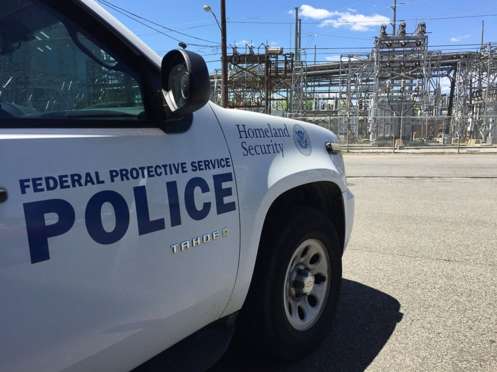 PHOTO: A Department of Homeland Security vehicle is parked near an electric companys equipment.
