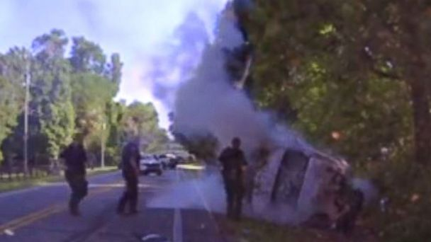 PHOTO: Dash cam footage shows Marion County sheriff's deputies saving a suspect from a burning car after a pursuit, April 23, 2017, in Marion Country, Fla.