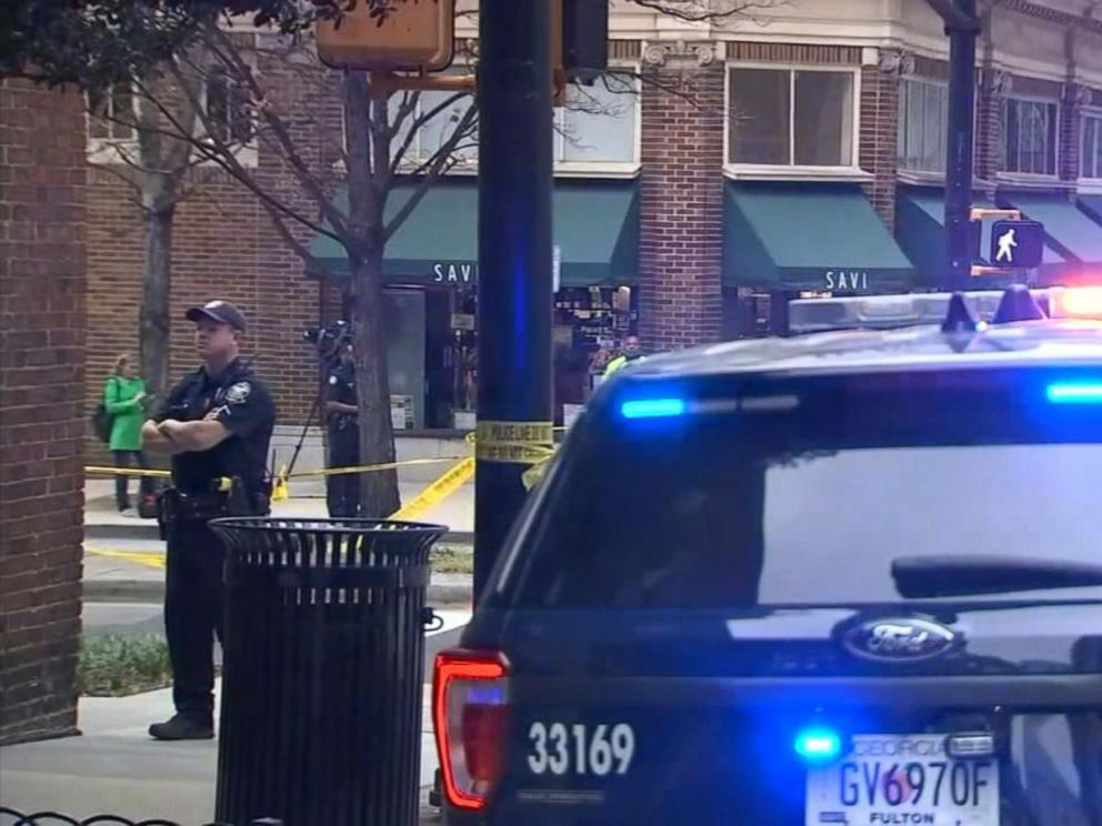 PHOTO: This still from video shows police in Midtown Atlanta after the targeted killing of a woman in broad daylight by a gunman, Apr. 3, 2017.