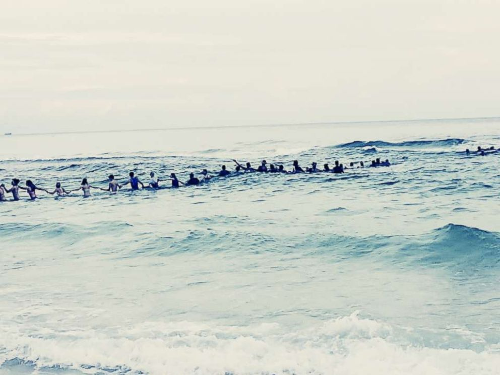 PHOTO: A group of strangers linked arms and waded into the ocean to rescue a group of swimmers stranded off the coast of Panama City Beach, Fla.