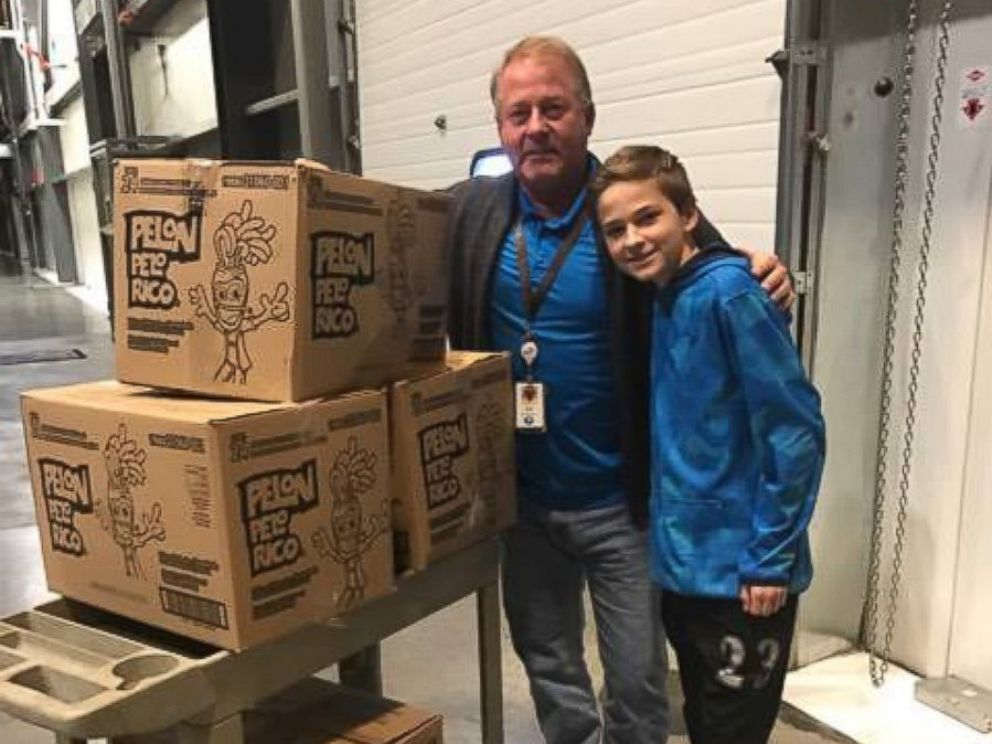 PHOTO: The general manger of the local Hershey distribution factory, Ed Ehrenberger, help Tryston and Anissa Brown load the boxes of donated chocolates into their car on Monday.