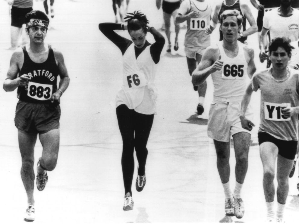 PHOTO: In 1972 Boston Marathon, women were officially allowed for the first time. A photographer caught Switzer pinning up her hair mid-race.