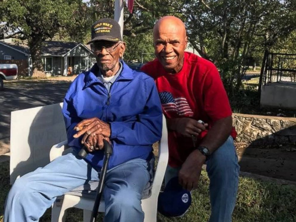 Volma Overton Jr., right, is pictured with Richard Overton, a World War II veteran who has lived in his Austin, Texas, home since the 1940s.