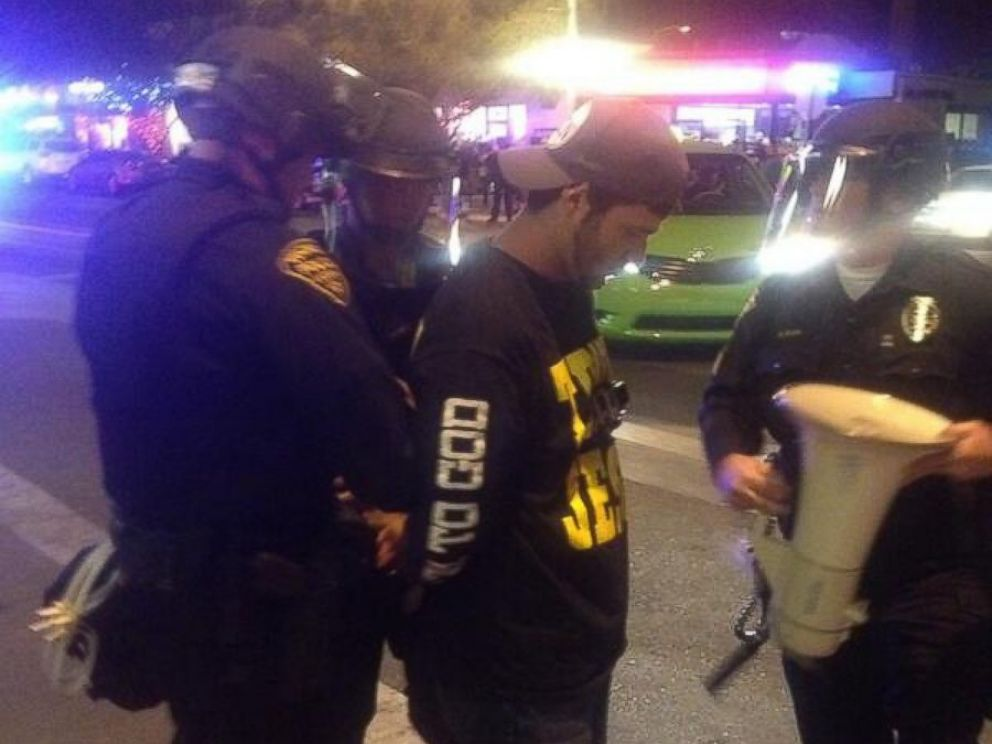 PHOTO: Brother Dean taken into custody by TPD Officers.