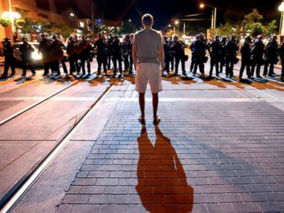 PHOTO: Lone man confronts Tucson Police.