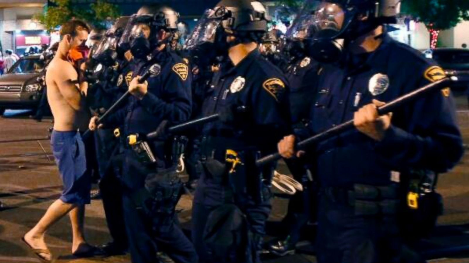 PHOTO: One man confronts the line of advancing Tucson Police.