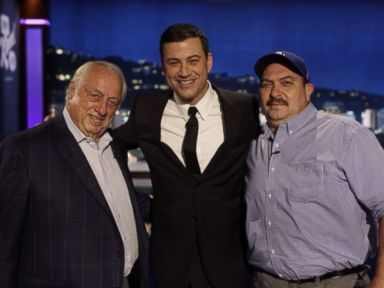 Tom Artiaga, who carried a man to safety from a Fresno, Calif. house fire, stands with former Dodgers manager Tommy Lasorda and Jimmy Kimmel on Jimmy Kimmel Live, Oct. 23, 2014.