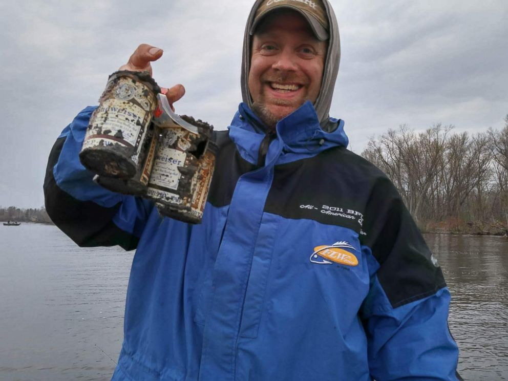 PHOTO: Andy Holst holds the Budweiser beer cans he and friends caught in Wisconsins Wolf River on April 17. Budweiser officials say the cans, caught in Wisconsins Wolf River, date back to at least 60 years.