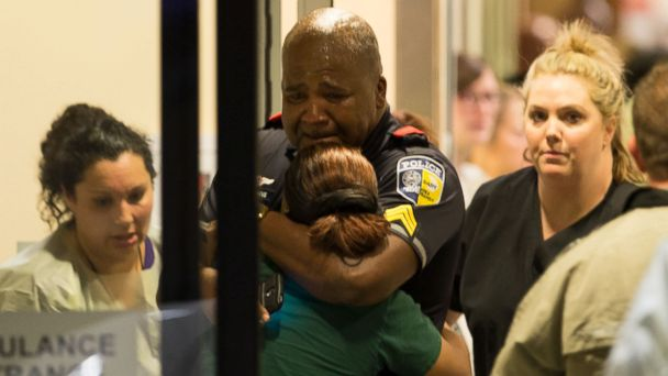http://a.abcnews.com/images/US/HT_DMN_Dallas_Police_Hugs_Woman_ml_160708_16x9_608.jpg