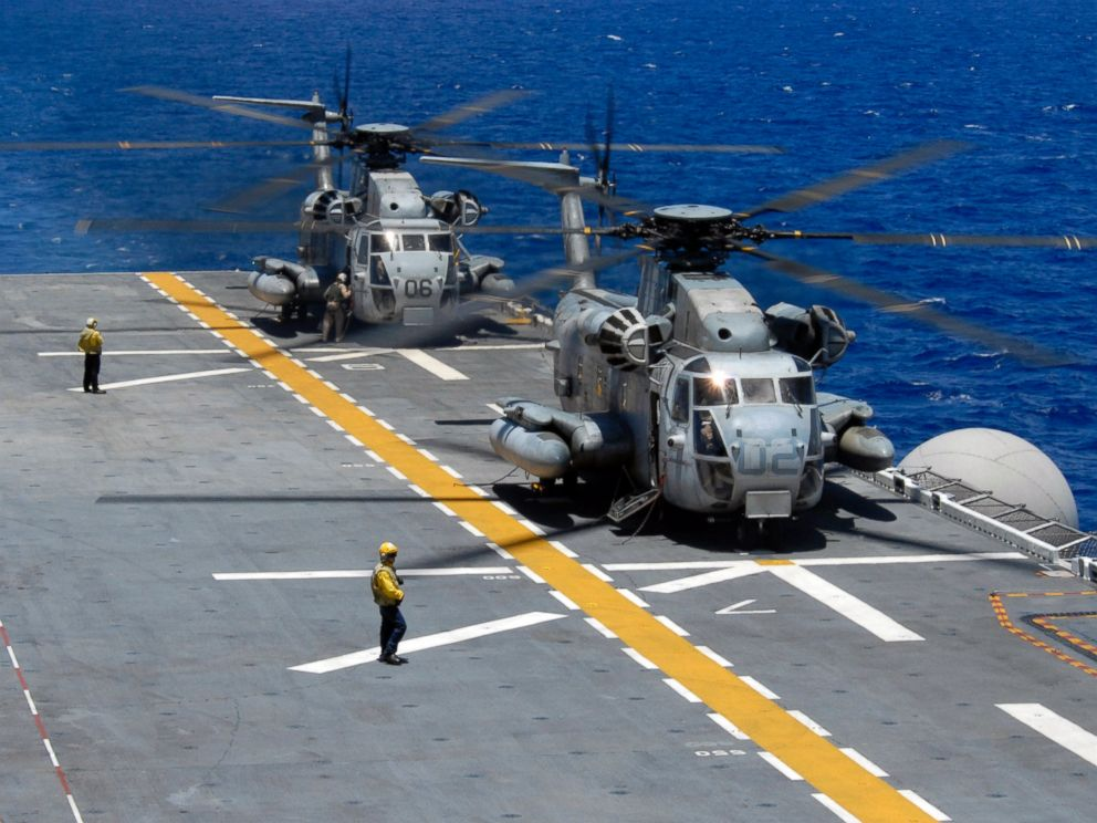 PHOTO: Two CH-53 Sea Stallions assigned to Marine Heavy Helicopter Squadron 362 idle on the flight deck of the amphibious assault ship USS Bonhomme Richard after fly-on exercises during Rim of the Pacific in 2008.
