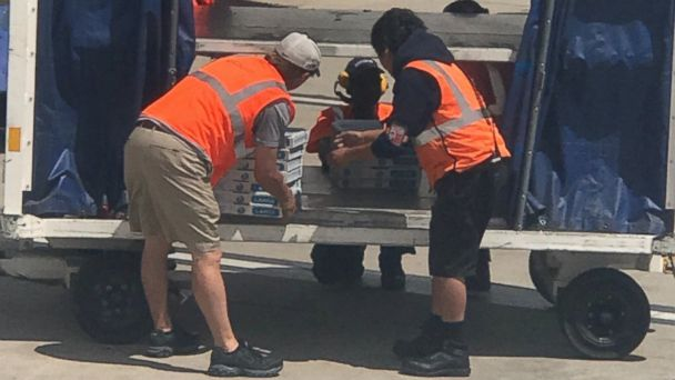 PHOTO: Workers delivering pizza to Delta Air Lines passengers who were impacted by flight cancellations and delays.