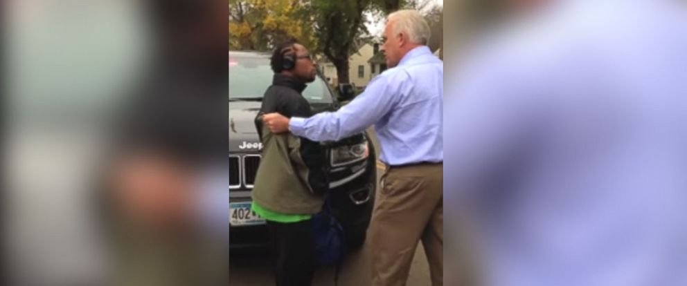PHOTO: This image from a video that was posted on YouTube, shows a man, Larnie Thomas, being held at the arm by an Edina police officer, who refuses to let go of him.