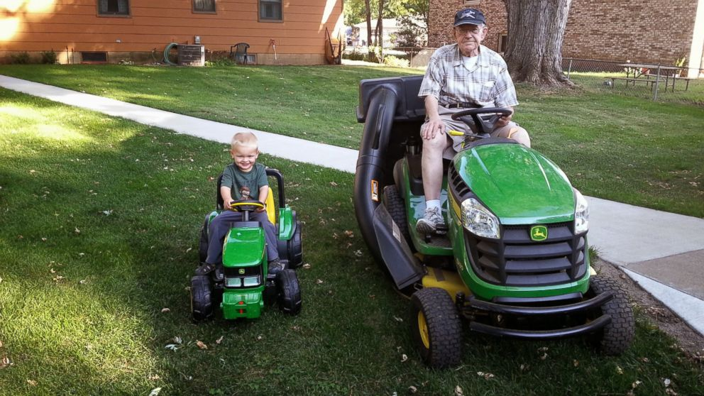 PHOTO: Emmett, left and Erling pose for a picture in their matching tractors.