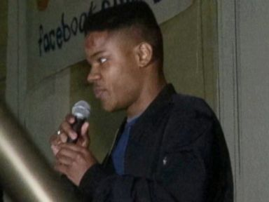 PHOTO: Martese Johnson speaks at a rally, March 18, 2015, at the UVA Campus in Charlottesville, Va.