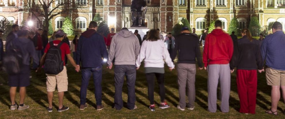 PHOTO: Students hold a vigil on the University of Oklahoma campus in Norman, Oklahoma, March 8, 2015.