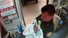 PHOTO: A SEPTA Transit Police officer is seen holding a baby following a birth on the Market-Frankford subway train, Dec. 25, 2014 in Philadelphia.