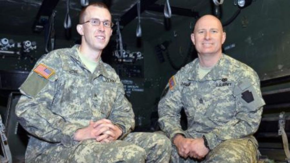 PHOTO: Pennsylvania National Guard members Sgt. Joseph S. Love, Headquarters Troop, 2nd Squadron, 104th Cavalry, and Sgt. 1st Class Daniel S. Famous, sit in the back of an ambulance on Jan. 24, 2014.