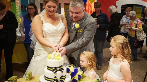 PHOTO: Anne and Mark Benson of Liverpool, England cut their SPAM-themed wedding cake at the SPAM Museum in Austin, Minnesota.