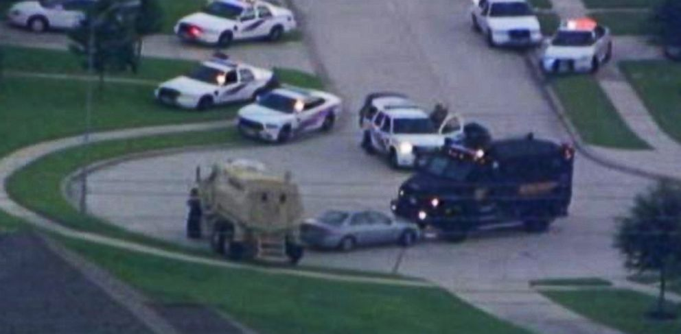 PHOTO: In this photo from video from ABC station KTRK-TV, two armored police vehicles surround a car in a cul-de-sac in Spring, Texas, on Wednesday, July 9, 2014.