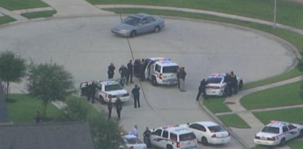 PHOTO: In this photo from video from ABC station KTRK-TV, police officers surround a car in a cul-de-sac in Harris County, Texas, on Wednesday, July 9, 2014.