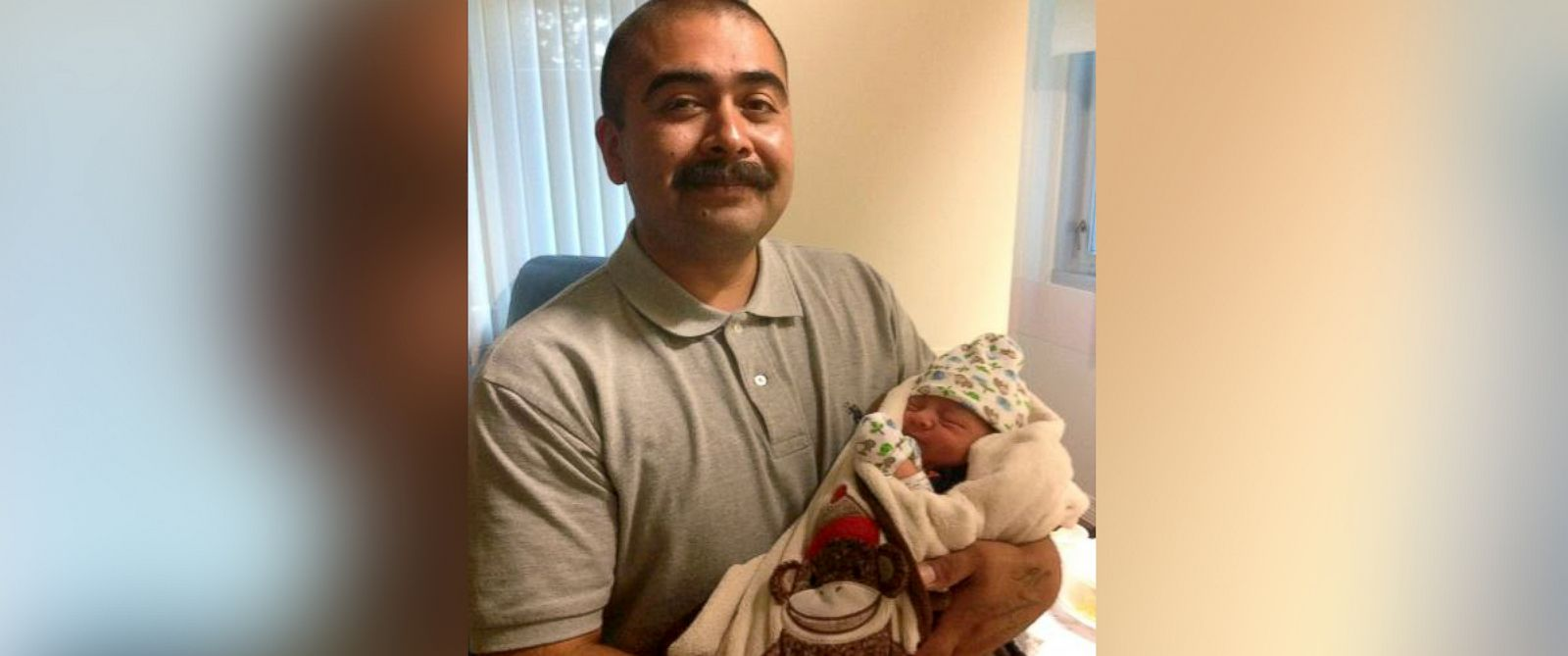 PHOTO: Angel Sanchez holds his newborn son Ismael Sanchez, who was born during a 6.0 earthquake that struck the Napa Valley area, at the Queen of the Valley Medical Center, Aug. 24, 2014.