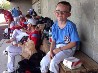 PHOTO: Pictured is Kaiser Carlile, the bat boy for the Liberal Bee Jays summer baseball team in Liberal, Kansas.