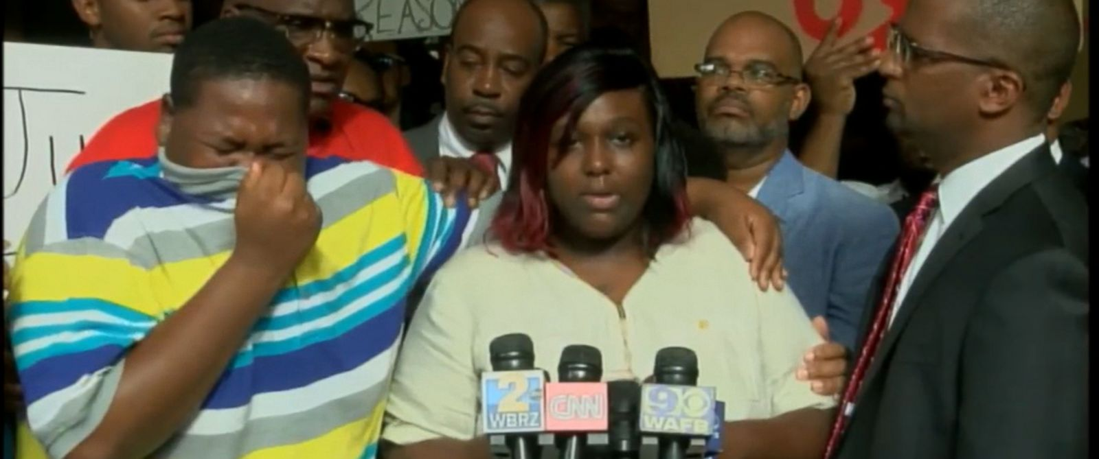 PHOTO: The son of Alton Sterling, a black man who was shot and killed during a confrontation with police officers in Baton Rouge, Louisiana, wept uncontrollably this morning as his mother spoke to the media.