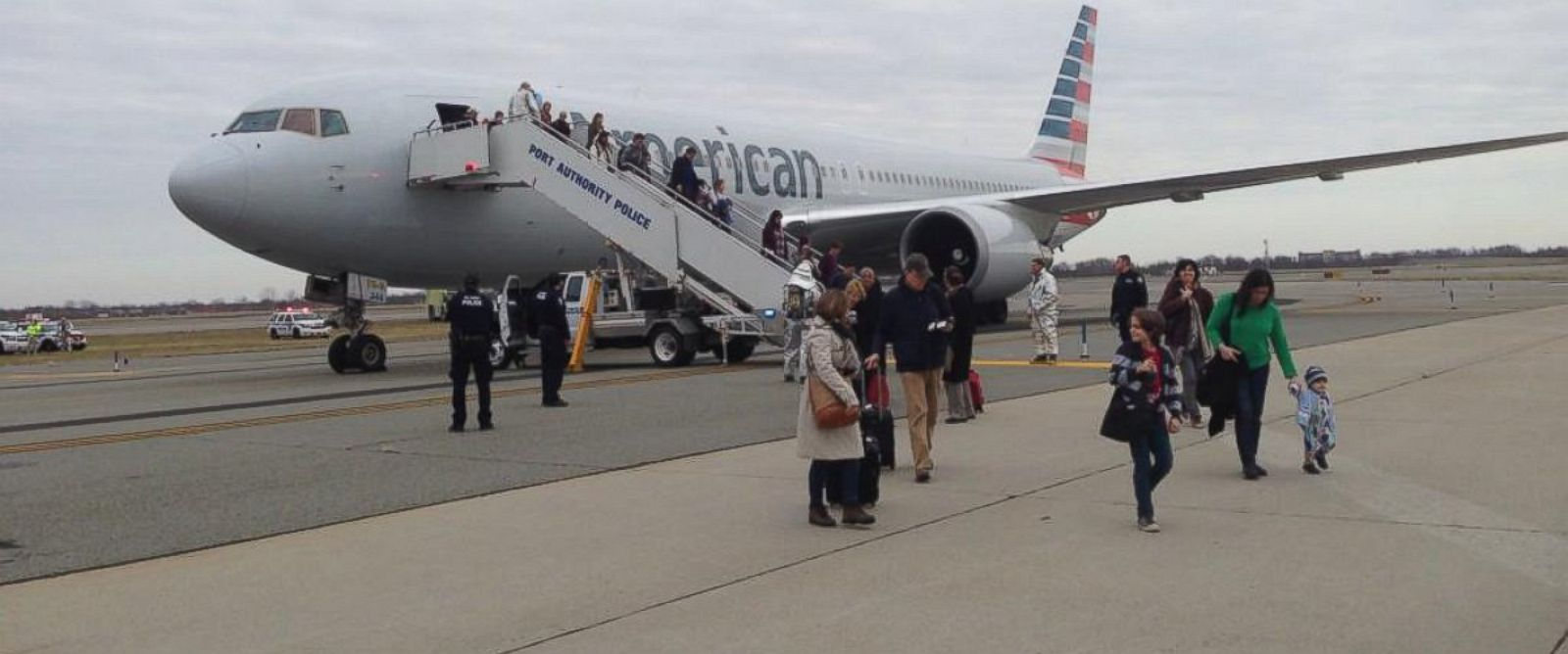 """PHOTO: Beth Henderson @bahenderson posted this photo to Twitter on Nov. 30, 2014 with the caption, """"Arrived in from Barcelona today and promptly escorted off, surrounded by police but at least were all safe."""""""