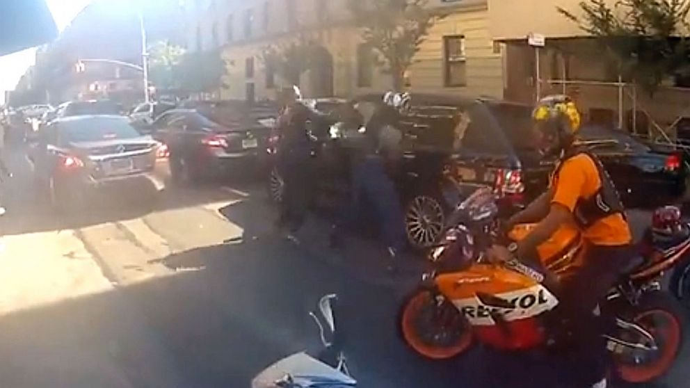 PHOTO: Daphne Avalon posted video, Black Range Rover Runs Over Bikers in NYC, on YouTube showing a biker and car chase ending in biker smashing th
