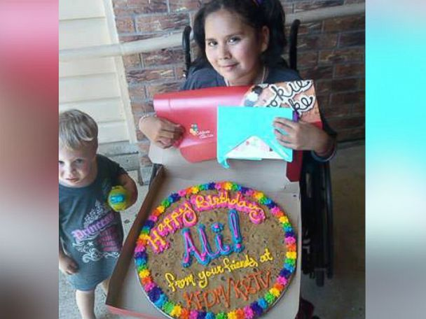 PHOTO: Ali poses with a birthday cookie cake given to her by the staff at the local news station that interviewed her, Aug. 6, 2014.