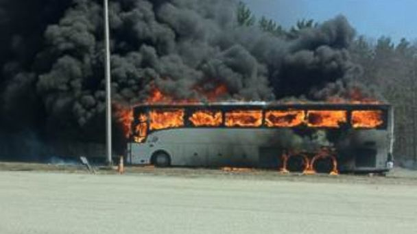 Bus engulfed in flames on massachusetts road