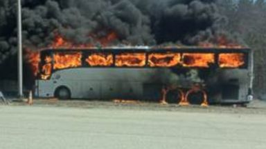 PHOTO: A bus fully engulfed in flames in Sturbridge, Massachusetts Saturday afternoon.