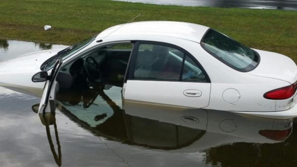 "PHOTO: A car trapped in flood waters where 8-10"" of rain fell in 24 hours."