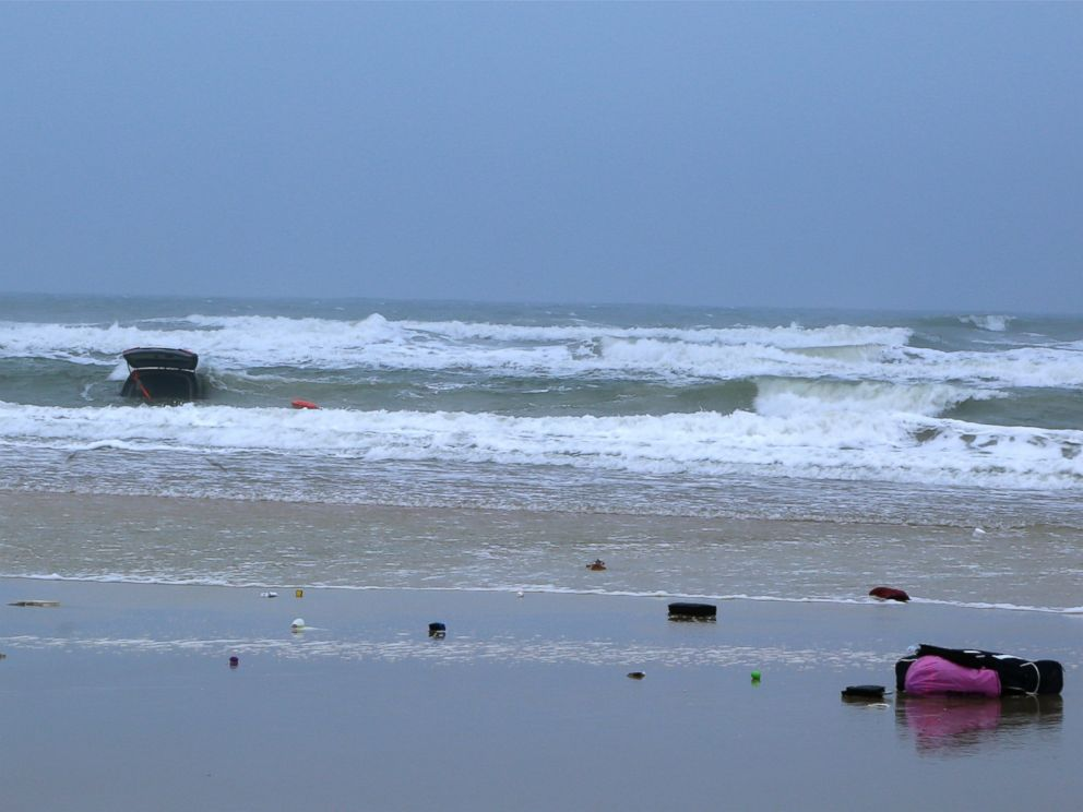 PHOTO: Debris is left on the beach after a mother and her children are rescued from their car, which was driven into the ocean, March 5, 2014 in Daytona Beach, Fla.
