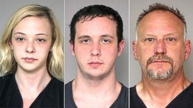 PHOTO: Abby Catt (left) and Hayden Catt (center) were recruited by their father Scott Catt (right) to rob banks.