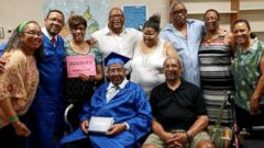 PHOTO: Charles Benning, a 92-year-old World War II veteran, center left, will receive his high school diploma at Yellow Springs High School in Ohio on May 28, 2015.