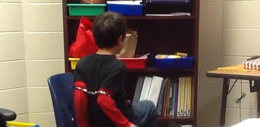 PHOTO: Video released Aug. 3, 2015 by the American Civil Liberties Union shows an 8-year-old boy handcuffed at an elementary school in Kentucky.