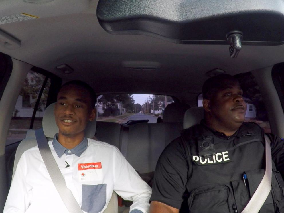 PHOTO: Chris Suggs rides with Sgt. Dennis Taylor of the Kinston Police Department.